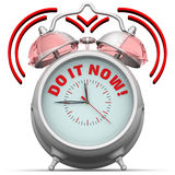 Do it now! The alarm clock with an inscription. Alarm clock with the words `DO IT NOW!`. 3D Illustration Stock Image