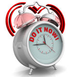 Do it now! The alarm clock with an inscription Royalty Free Stock Image