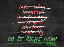 Do it now. Blackboard with concept do not procrastinate but take action now Stock Images