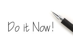 Do it Now!. Do it now concept with pen against white background Stock Photos