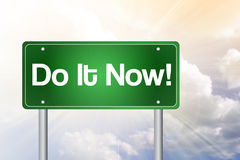 Do It Now! Green Road Sign Stock Photos