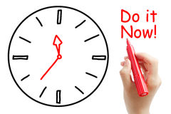 Do it Now!. Hand with red marker writing do it now Concept isolated on white background Royalty Free Stock Photo