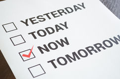 Do it now motivation concept. Motivation concept. A4 checklist Yesterday, today, now, tomorrow Royalty Free Stock Photography