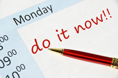 Do it now note. In the agenda Stock Image