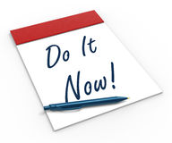 Do It Now! Notebook Shows Motivation Or Stock Image