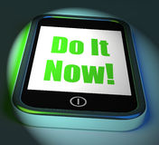 Do It Now On Phone Displays Act Immediately Royalty Free Stock Photography