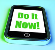 Do It Now On Phone Shows Act Immediately Royalty Free Stock Image