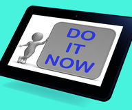 Do It Now Tablet Shows Encouraging Immediate Action Stock Photography
