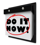 Do It Now Wall Calendar Urgent Demand Deadline. A wall calendar with the words Do It Now to symbolize the importance of completing a task or beating an urgent Stock Photos