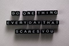 Do one thing everyday that scares you on wooden blocks. Motivation and inspiration concept stock photography