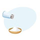 Do pour salt from salt shaker Royalty Free Stock Image