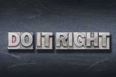 Do it right den. Do it right phrase made from metallic letterpress on dark jeans background stock photo