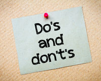 Do's and Don't's. Message. Recycled paper note pinned on cork board. Concept Image Stock Photos