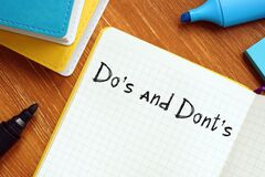 Do`s And Dont`s phrase on the piece of paper