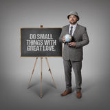 Do small things with great love. text on blackboard with businessman Royalty Free Stock Photos