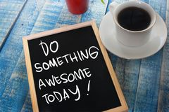 Do Something Awesome Today. Motivational inspirational quotes words. Wooden background stock photography