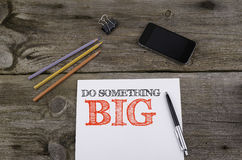 Do Something Big. Wooden table Stock Photos