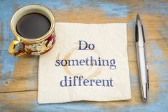 Do something different advice on napkin. Do something different advice - handwriting on a napkin with a cup of coffee Stock Photos