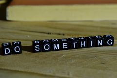 Do something on wooden blocks. Motivation and inspiration concept. Cross processed image royalty free stock photos