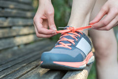Do up the shoelaces on a park bench Royalty Free Stock Images