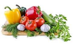 Do verão vida ainda que consiste nos vegetais isolados sobre o branco Imagem de Stock Royalty Free