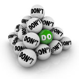 Do Vs Don't Ball Pyramid Permission Approval Attitude. Several balls marked Don't in a pyramid and one with the word Do to illustrate permission, acceptance and royalty free illustration