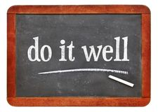 Do it well - motivational note on blackboard Stock Images
