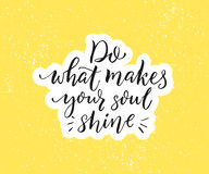 Do what makes your soul shine. Positive inspirational quote. Black brush calligraphy on yellow background. Motivational Stock Photos