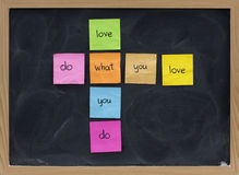 Do what you love concept on blackboard stock photo