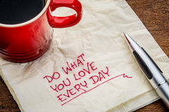Do what you love every day - text on napkin Stock Photo