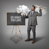 Do what you love  text on blackboard with businessman Royalty Free Stock Image