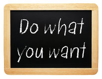Do what you want sign. The words do what you want written on a blackboard or chalkboard stock photography