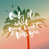 Only do what your heart tells you, Inspirational saying on filtered silhouette of tropical palm tree. Royalty Free Stock Photos