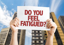 Do You Feel Fatigued? card with cityscape background stock photography