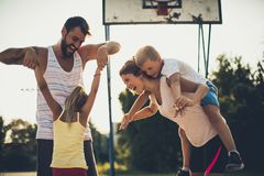 Do you have fun?. Family on basketball court stock photography