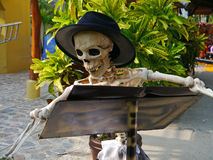 Do you have a reservation?. A skeleton at a restaurant is used as a humorous decoration at an outdoor patio to celebrate the Day of the Dead (Hallowe'en) on the royalty free stock image