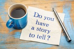 Do you have a story to tell?. Handwriting on a napkin with a cup of espresso coffee Stock Photography