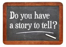 Do you have a story to tell?. White chalk text on a vintage slate blackboard Stock Photos