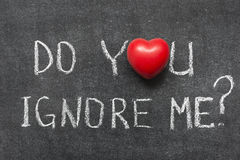 Do you ignore me. Question handwritten on blackboard with heart symbol instead of O Stock Image