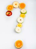 Do you like fruit?. Photo cut oranges and apples arranged in a question mark royalty free stock photo