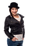 Do you like my new outfit?. Young woman posing with leather jacket over white Stock Images