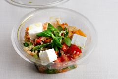 FOOD. Spinach salad with quinoa and organic tomatoes, marinated tomatoes and tomatoes royalty free stock images