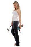 Do you need a handyman. Pretty woman holding two powertools royalty free stock photo