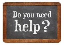 Do you need help?. White chalk text on a vintage slate blackboard Royalty Free Stock Photos