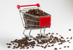Do you need some coffee?. Shopping cart with coffee Stock Image