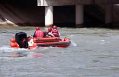 Do You See Him?. A team of emergency crew members practicing water rescue skills on a swollen river Stock Photography