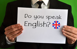 Do you speak English. Businessman showing a sheet with text Do you speak English Stock Photo