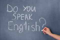 Do you speak English?. Sentence written on the blackboard: Do you speak English Stock Image