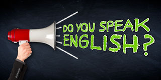 Do you speak english? wide megaphone blackboard education backgr. Do you speak english? wide slate blackboard chalkboard with hand holding megaphone business Stock Photo