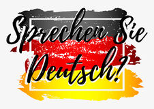 Do you speak German. Conceptual lettering with paint splashes in shape of Germany flag in grunge style in black red yellow colors on grey background. Translation Stock Photo